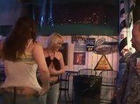 Развратные девки показывают в баре голые сиськи